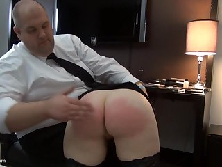 She sucks his cock dry with her ass swollen from spanking