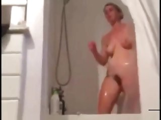 Spying my stepmom let my cum flow