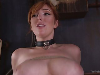 Tied up busty redhead Lauren Phillips deserves hard missionary fuck