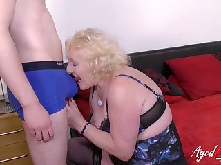 Grandma strips a young guy to play with him