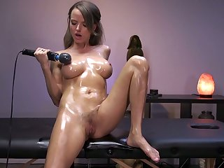 Oiled up seductress Pristine Edge is testing new vibrator and sex machine
