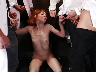 Skinny redhead surrounded by dicks and faced to fuck merciless