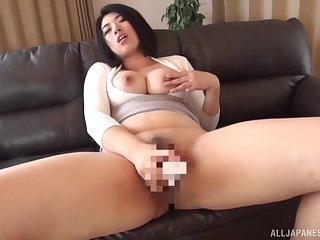 Busty Japanese works magic with her toy dicks