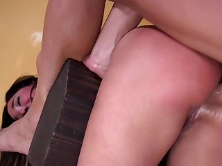 Bent over brunette is anal fucked