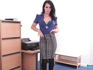 Naughty alone brunette secretary Jasmine Lau starts stripping and flashes ass