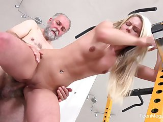 Martina D gets fucked from behind by an older dude in the gym
