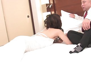 Japanese housewife Yoa Yamashita gets licked and fucked on the bed