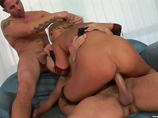 Tanned blonde gets dirty with two potent males