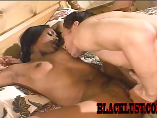 Hot ebony lover gets fucked on the bed and earns a facial