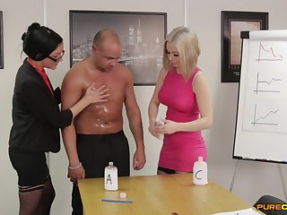 Clothed office females are intrigued about this man's capabilities