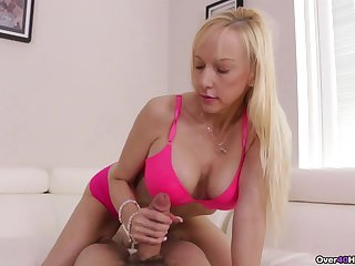Sexy blonde with big tits, nude mommy handjob at home